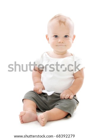 Baby Boy smiling, sitting with a spoon - stock photo