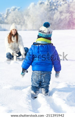 Baby boy son and mother are happy together - winter day - stock photo