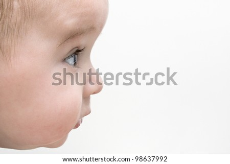 Baby boy watching something with interest - stock photo