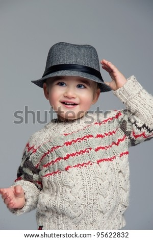Baby boy wearing a hat. - stock photo