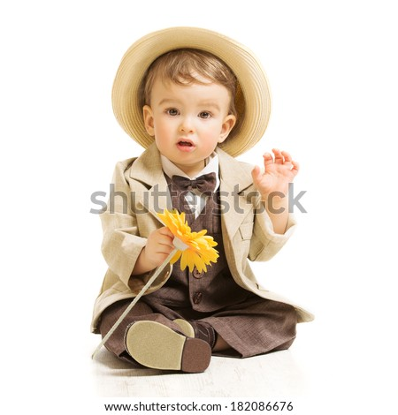 Baby boy well dressed in suit with flower. Vintage children style, white background  - stock photo