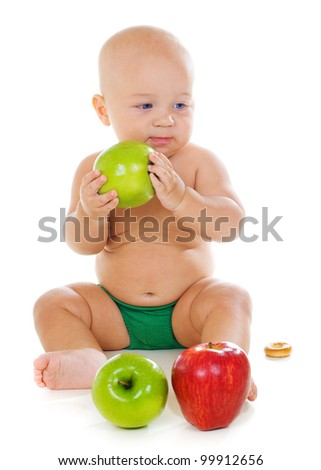 baby boy with apples on white background