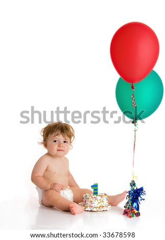 baby boy with cake and balloons - stock photo