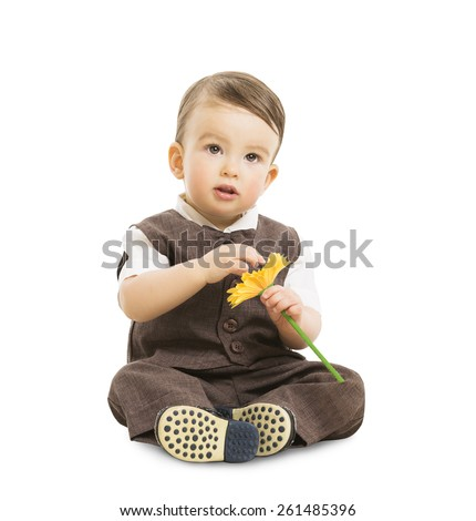 Baby Boy with Flower, Well Dressed Kid in Suit. Children Retro Style, One Year Old Child Sitting Isolated Over White Background - stock photo