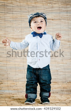 baby boy with gentleman outfit on bamboo background