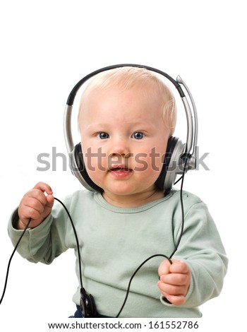 Baby boy with headphones, isolated - stock photo