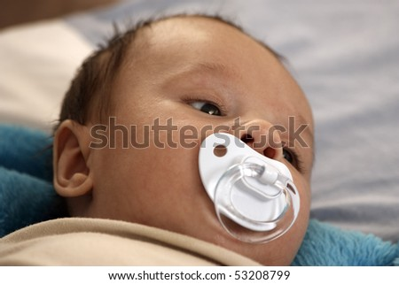 Baby boy with pacifier - stock photo