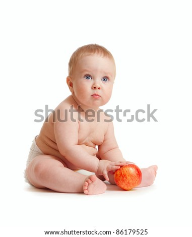 Baby boy with red red apple - stock photo