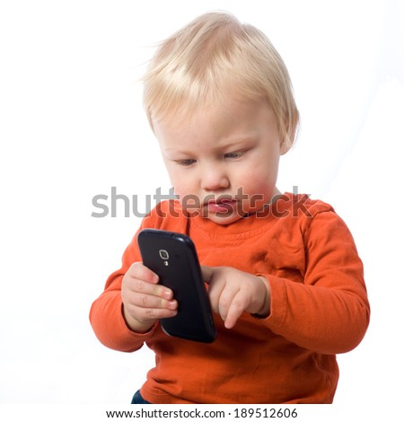 Baby boy with smart phone, isolated on white - stock photo