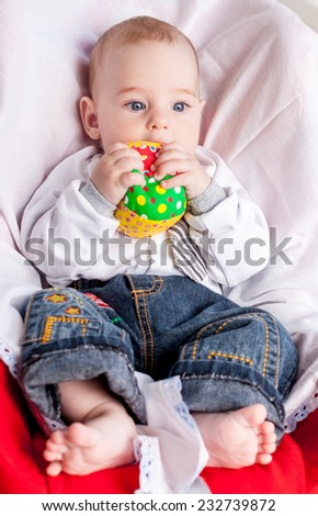 Baby boy with soft ball - stock photo