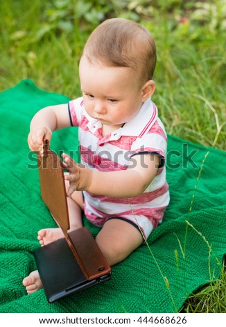 Baby boy with tablet computer. Little boy with touch pad, early learning