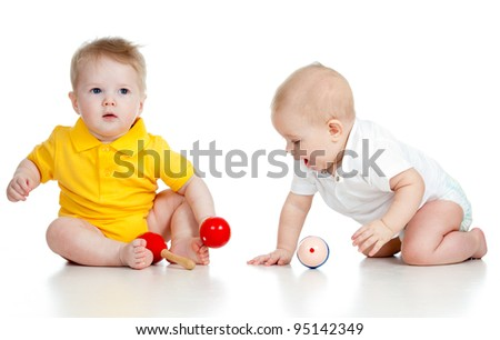 Baby boys with musical toys. Isolated on white background