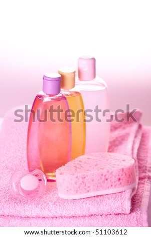 Baby care objects. Olive, shampoo, gel, towels, sponge and dummy - stock photo