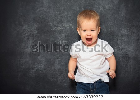 baby child and an empty Blackboard - stock photo