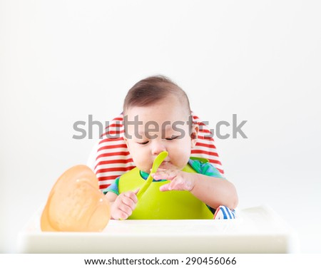 baby child eating in chair