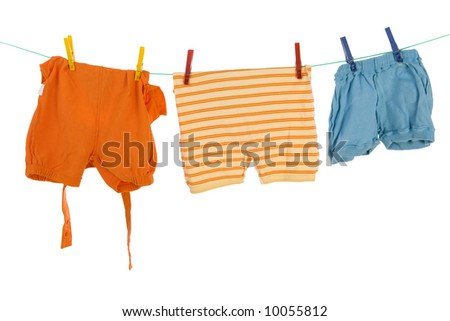Baby clothes hang on clothesline. Front view. White background - stock photo