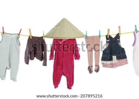 Baby clothes hanging on washing line