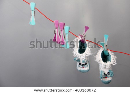 Baby Clothes on a clothesline - stock photo