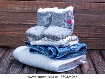 baby clothes on a table - stock photo