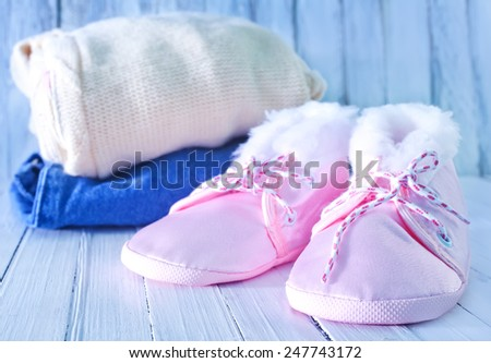 baby clothes on a table, clothes for little baby girl - stock photo