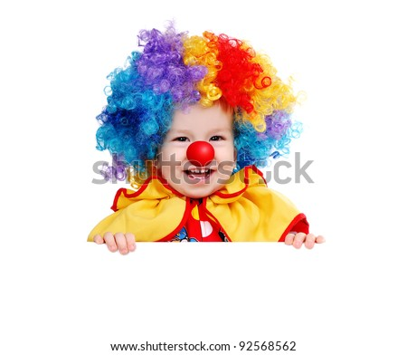 Baby clown with red nose holding the white board - stock photo
