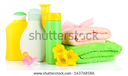 Baby cosmetics and towels, isolated on white - stock photo