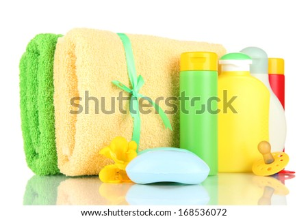 Baby cosmetics, soap and towels, isolated on white - stock photo