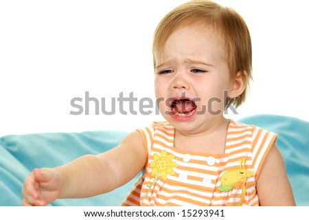 Baby Crying and reaching for something on white background - stock photo