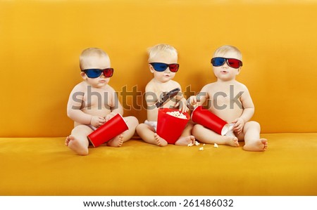 Baby 3D Glasses Watching Film On TV, Children Eating Popcorn And Watch Cinema Movie In Home Theater, Kids In Diapers With Remote Control - stock photo