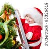 Baby decorating Christmas tree, isolated - stock photo
