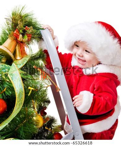 Baby decorating Christmas tree, isolated - stock photo