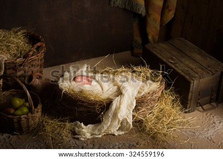 Baby doll acting as Jesus in a Christmas Nativity scene - stock photo