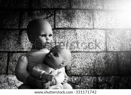 Baby doll toy sit in room on grunge background and light ray,Still life,Black and white,hope concept - stock photo