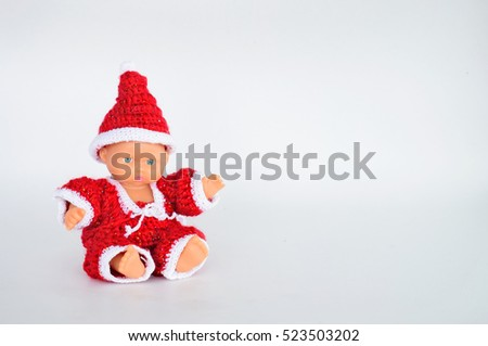 Baby dolls dressed in Santa Claus put on a white background. /The dolls are common. /With copy space