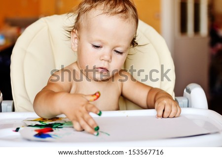 baby drawing with her fingers