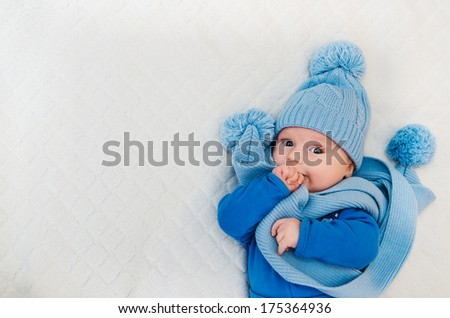 baby dressed in winter scarf and cap - stock photo