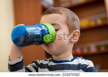 Baby drinking from bottle - stock photo