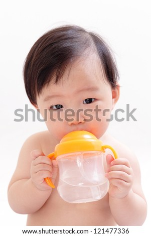 Baby drinking water from a bottle, asian child - stock photo