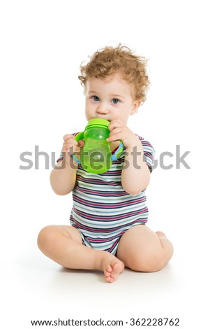 Baby drinking water from cup - stock photo