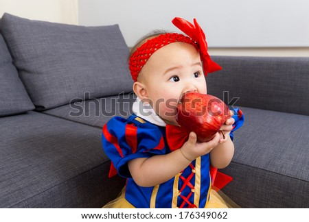 Baby eat apple with halloween party dressing