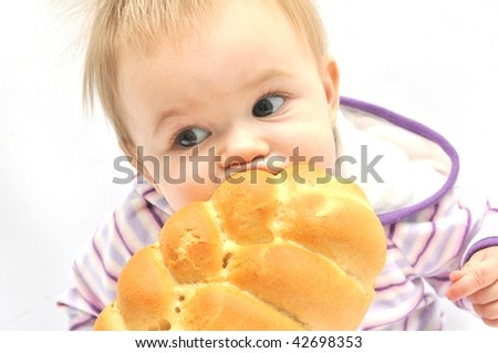 baby eat Christmas Cake on white background - stock photo