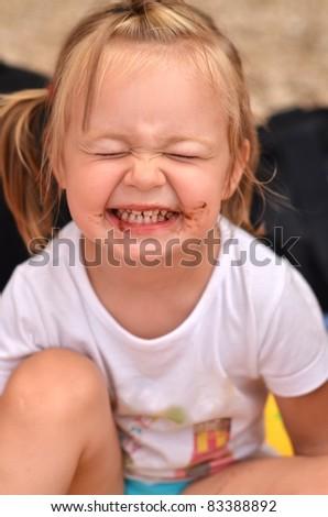 baby eating chocolate - stock photo