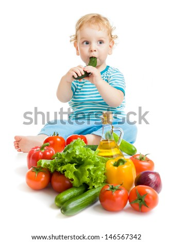 baby eating healthy food vegetables on white background - stock photo