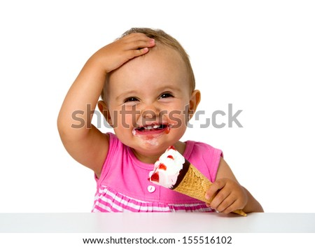 baby eating ice cream isolated on white - stock photo