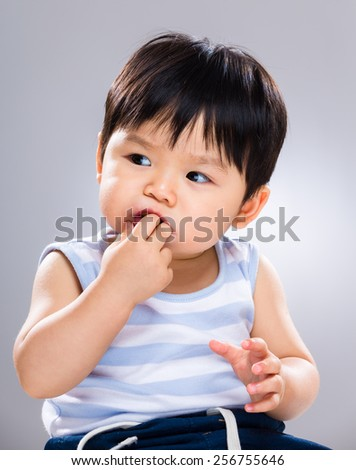 Baby eating snack - stock photo