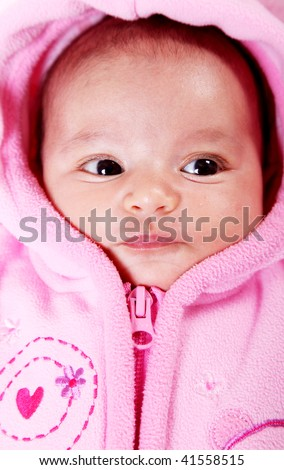 Baby face with pink hood. Open eyes - stock photo