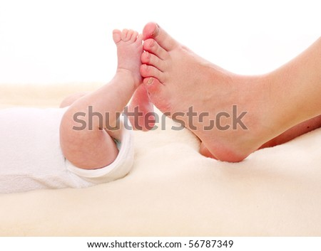 Baby feet and mother's feet. Little and big. - stock photo