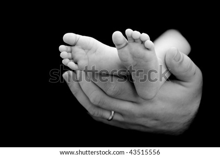 Baby Feet in Father's Arm