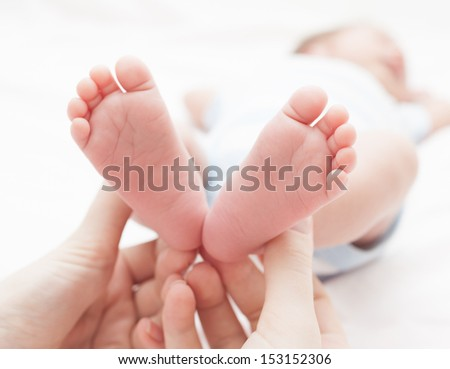 Baby feet in mothers hands