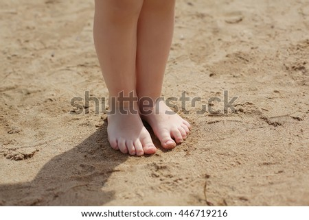 baby feet in the sand